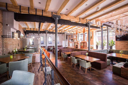 Photo for Interior of spacious modern restaurant with wooden floor - Royalty Free Image