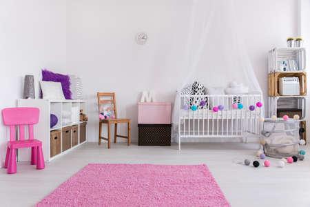 Photo pour Shot of a white nursery with pink accessories - image libre de droit