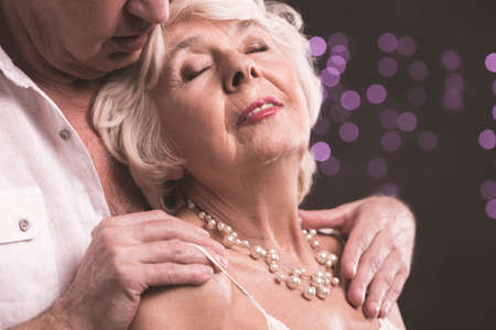 Shot of an elderly man caressing his wife