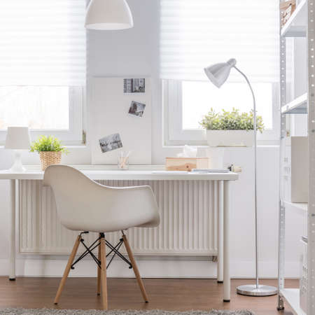 Picture of simple white study area in teenager room
