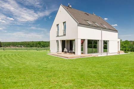 Shot of a modern detached house with a big backyard