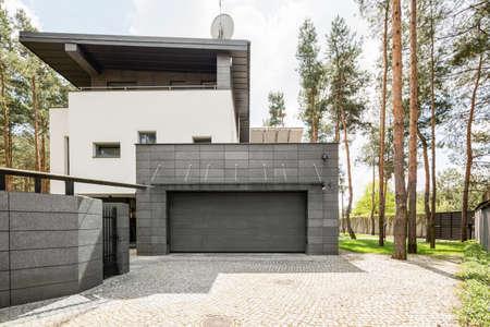 Shot of a big modern house and its garage