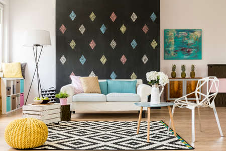 Modern flat with blackboard, pattern carpet, new crystal chair, yellow pouffe and sofa