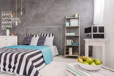 New design bedroom with window, comfortable bed and decorative wall plaster
