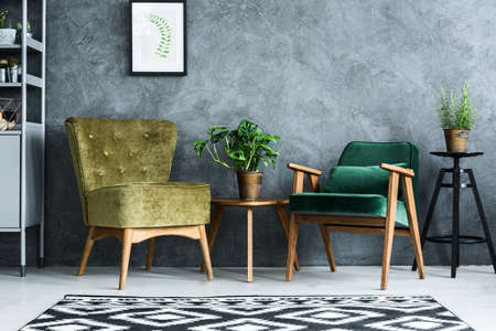 Photo pour Apartment with modern armchairs and cyan wall - image libre de droit