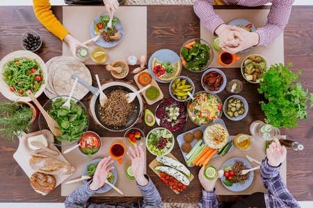Various vegan and vegetarian food lying on rustic table