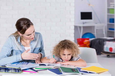 Mother and child having problem with concentration while doing homework