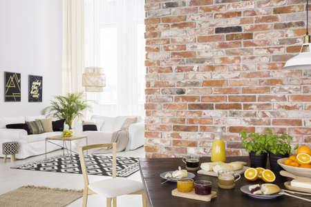 Photo for Dining room open to bright living room with sofa - Royalty Free Image