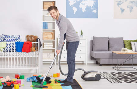 Happy first time dad vacuuming child's room
