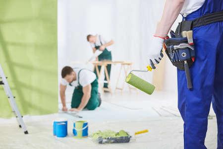 Photo pour Professional interior renovation crew at work in house - image libre de droit