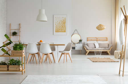 Photo pour White and modern dining room with wooden furniture - image libre de droit