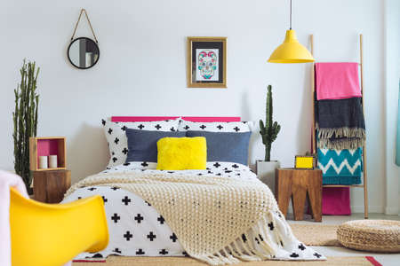 Photo for Festive bedroom of folk lover, mix of styles and materials - Royalty Free Image