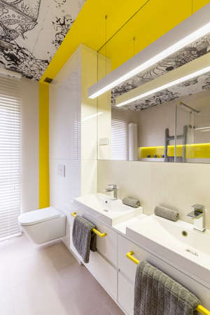 White and neon yellow bathroom design idea, yellow handles, double sink, toilet, graphic ceiling and window