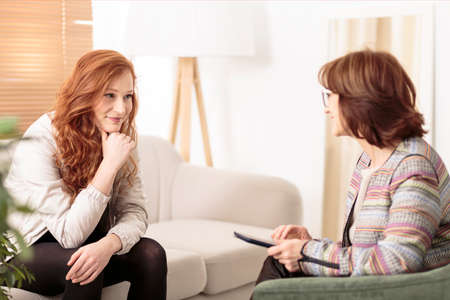 Smiling woman talking to a wellness coach to find motivation to achieve physical health goals
