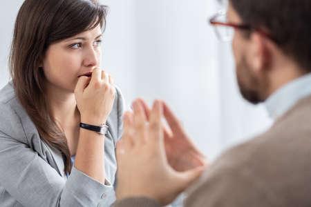 Foto de Sad beautiful young woman with social problems during psychotherapy - Imagen libre de derechos