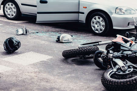 Photo pour Helmet, mirror and a car lamp between car and motorcycle after terrible road accident - image libre de droit