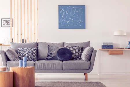 Photo pour Elegant scandinavian living room interior with blue painting on wall and console table with lamp - image libre de droit