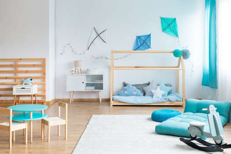 Photo for Do it yourself blue kites on empty white wall in scandinavian bedroom for kid - Royalty Free Image
