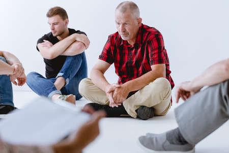 Photo pour Group of men exercising their imagination during psychotherapy - image libre de droit