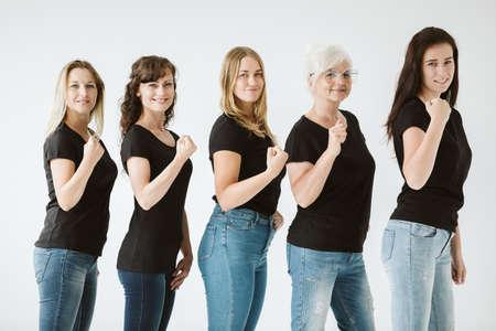 Photo pour Group of women in different age wearing black t-shirts - image libre de droit