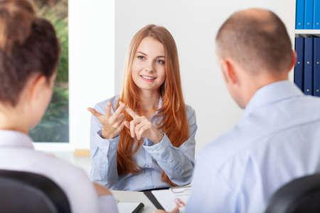 Photo pour Confident young woman pointing her advantages during the recruitment interview - image libre de droit