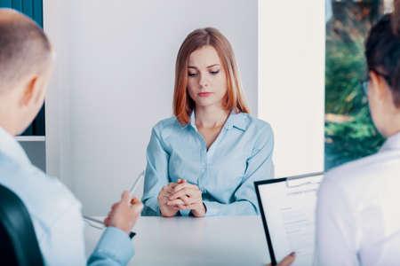 Photo pour Nervous young apprentice during a job interview in a corporation - image libre de droit