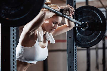 Photo for Close-up of young female bodybuilder taking break after training at crossfit center - Royalty Free Image