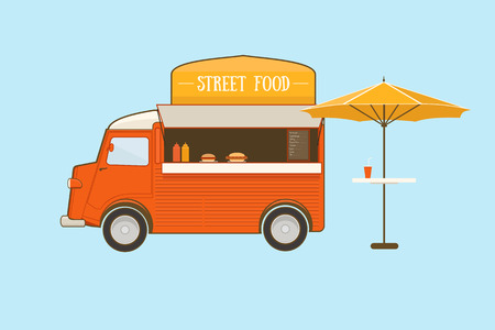Street food truck with umbrella on blue background