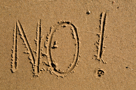 Casual writing in the wet sand on a sunny day.