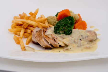 chicken piccata with capern and salad,Grilled chicken breasts and vegetables,chicken breast with fresh cherry tomatoes