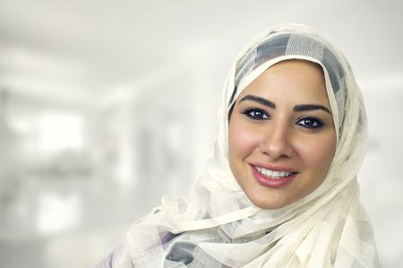 Photo pour Portrait of a beautiful Arabian Woman wearing Hijab, Muslim Woman wearing Hijab - image libre de droit