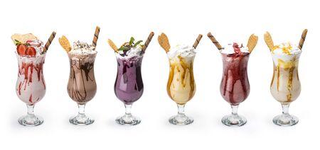 Foto de Fresh tasty cocktails, Glasses with delicious milk shakes isolated on white background - Imagen libre de derechos