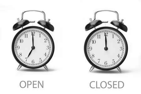 Photo for Sign showing business opening hours Black and white image Isolated on white background Close-up - Royalty Free Image