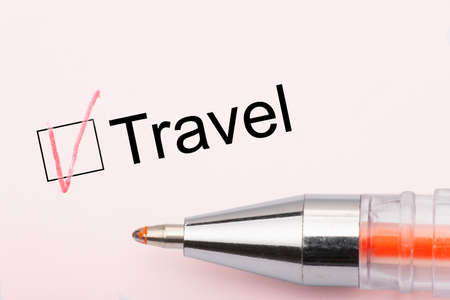 Photo pour Travel - checkbox with a cross on white paper with pen. Checklist concept. Close-up - image libre de droit