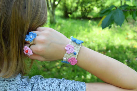 Crocheted your own jewelry. Pink and blue bracelet and ringlet on young girl. Step 3 - finished goods. DIY project. Small business. Income from hobby.