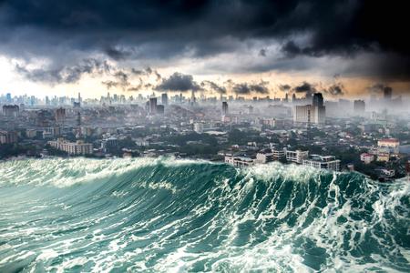 Foto de Conceptual nature disaster city destroyed by Tsunami waves - Imagen libre de derechos