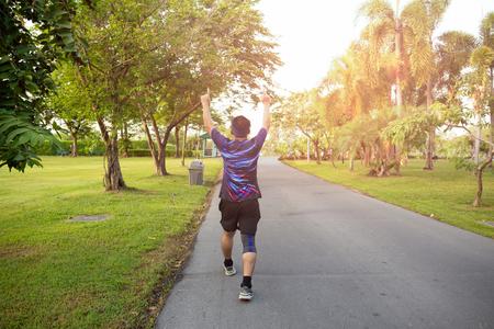 Foto de Unidendified man winner celebrating sport success raising hands up. - Imagen libre de derechos