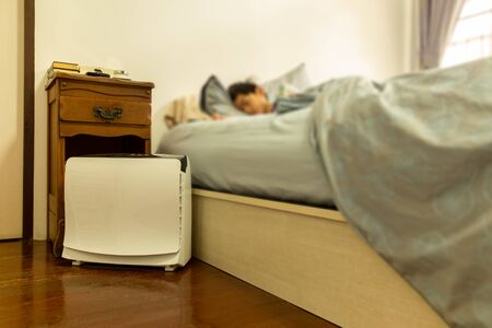 Photo pour Air purifier in the bed room help young child a good sleep. - image libre de droit