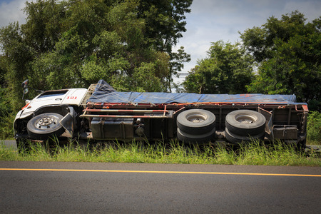 overturned truck accident on highway road.