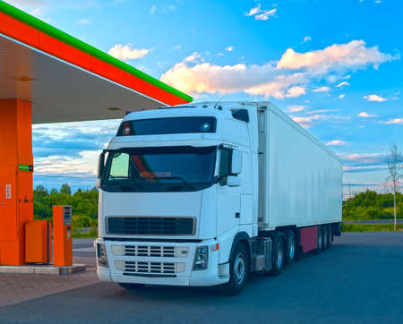 Photo for White truck is at the fuel station in sunny summer day - Royalty Free Image