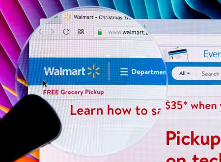 Sankt-Petersburg Russia December 7, 2017: Walmart homepage website on Apple iMac monitor screen under magnifying glass. Walmart is an American multinational retailing corporation.