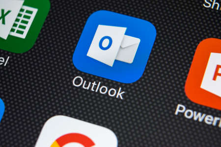 Sankt-Petersburg, Russia, February 22, 2018: Microsoft Outlook application icon on Apple iPhone X screen close-up. Microsoft outlook app icon. Microsoft OutLook application. Social media