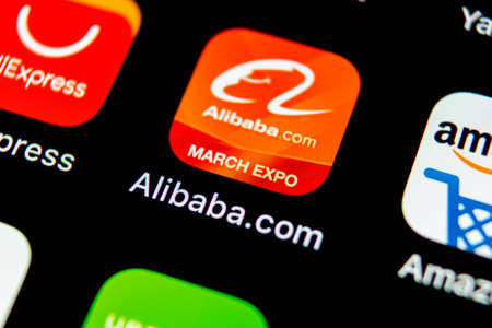 Photo pour Sankt-Petersburg, Russia, May 10, 2018: Alibaba application icon on Apple iPhone X smartphone screen close-up. Alibaba app icon. Alibaba.com is popular e-commerce application. Social media icon - image libre de droit