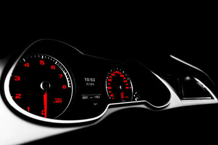 Photo for Close up shot of a speedometer in a car. Car dashboard. Dashboard details with indication lamps.Car instrument panel. Dashboard with speedometer, tachometer, odometer. Car detailing. Black and white - Royalty Free Image