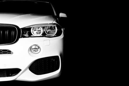 Photo pour Headlight of a modern white sport car. The front lights of the car. Modern Car exterior details. Car detailing. Isolated on black background. Car detailing. Front view - image libre de droit
