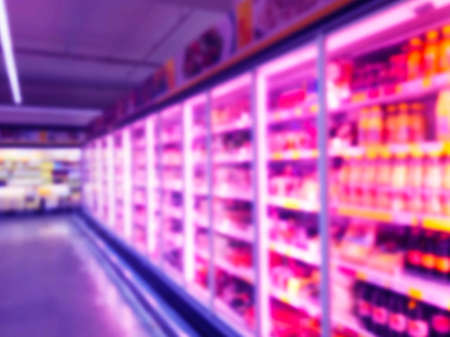 Photo pour Abstract blurred supermarket store and refrigerators in department store. Interior shopping mall defocused background. Business food. Bokeh light background. Blur supermarket. Drink zone concept - image libre de droit