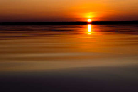 Photo for Water surface. View of a Sunset sky background. Dramatic gold sunset sky with evening sky clouds over the sea. View of a Crystal clear sea water texture. Landscape. Small waves. Water reflection - Royalty Free Image