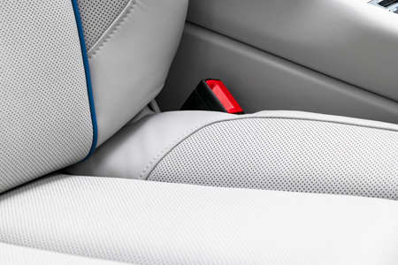 Photo pour White leather interior of the luxury modern car. Perforated white leather comfortable seats with stitching isolated on black background. Modern car interior details. Car detailing. Car inside - image libre de droit