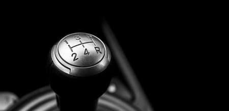 Photo pour Close up view of a manual gear lever shift isolated on black background. Manual gearbox. Car interior details. Car transmission. Soft lighting. Abstract view. Car detailing - image libre de droit