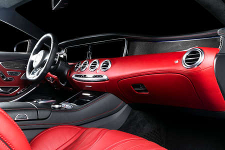 Photo for Red luxury modern car Interior with steering wheel, shift lever and dashboard. Clipping path. Detail of modern car interior. Automatic gear stick. Part of leather seats with stitching in expensive car - Royalty Free Image
